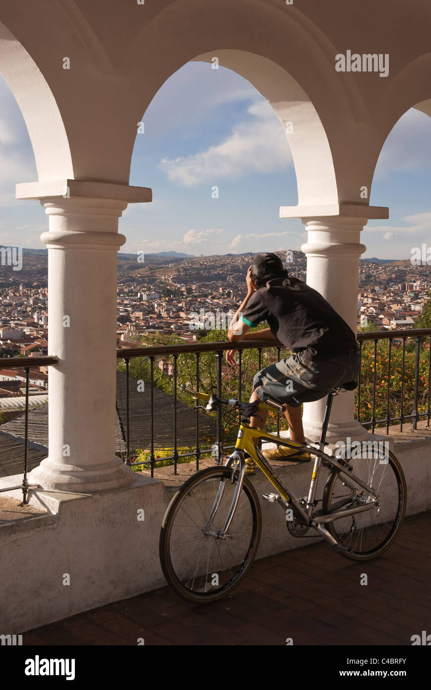 Sucre, Plaza Anzures, colonnade with bicyclist enjoying view - Stock Image