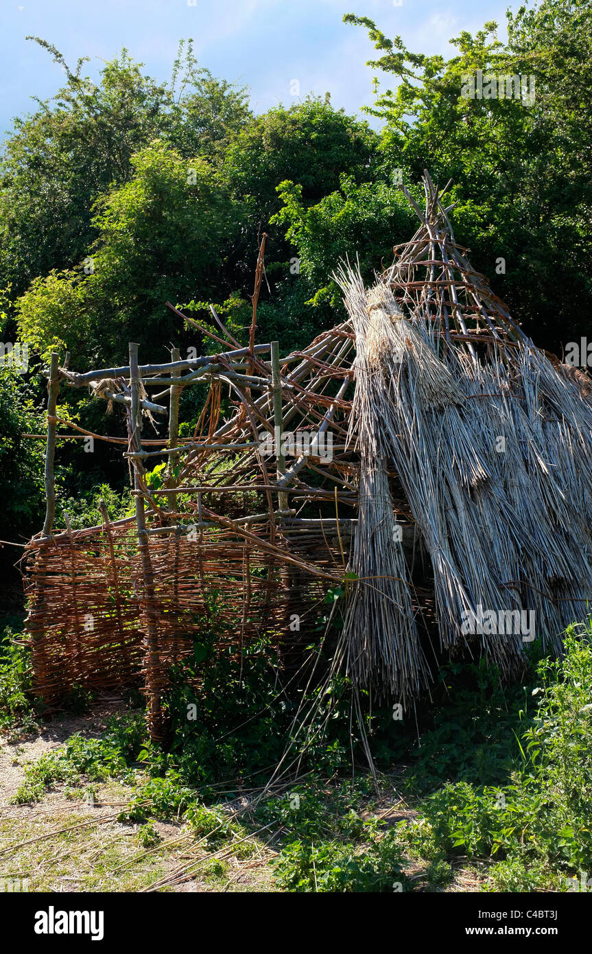 Straw House, primitive dwelling made from sticks and reeds - Stock Image