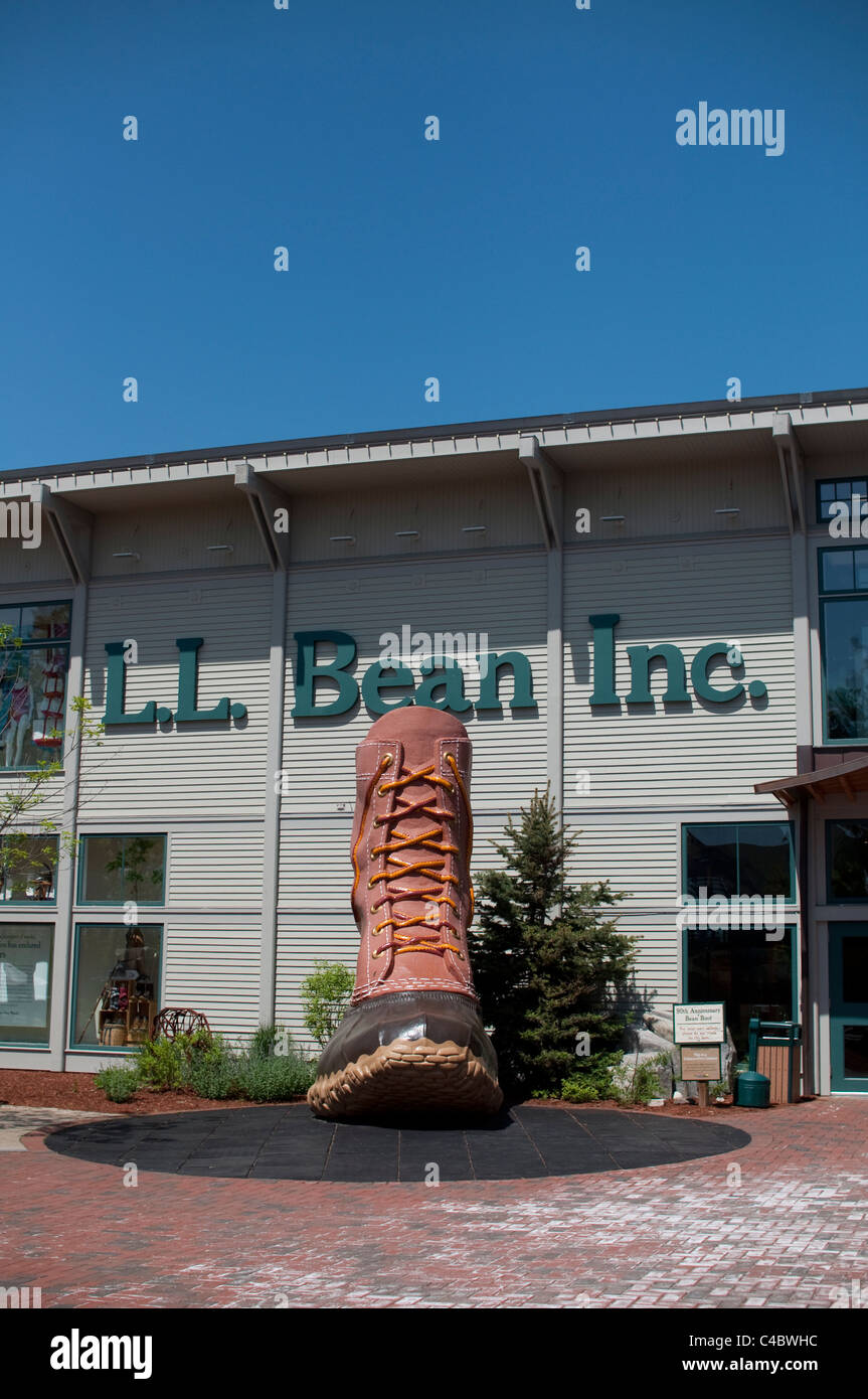 A giant sculpture of the Bean hunting boot greets shoppers at the entrance to L.L. Bean in Freeport, Maine, USA. - Stock Image