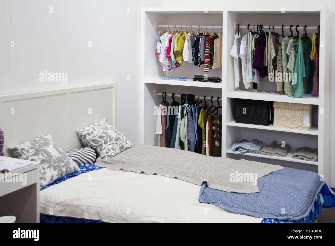 bedroom with large bed and garderobe - Stock Image