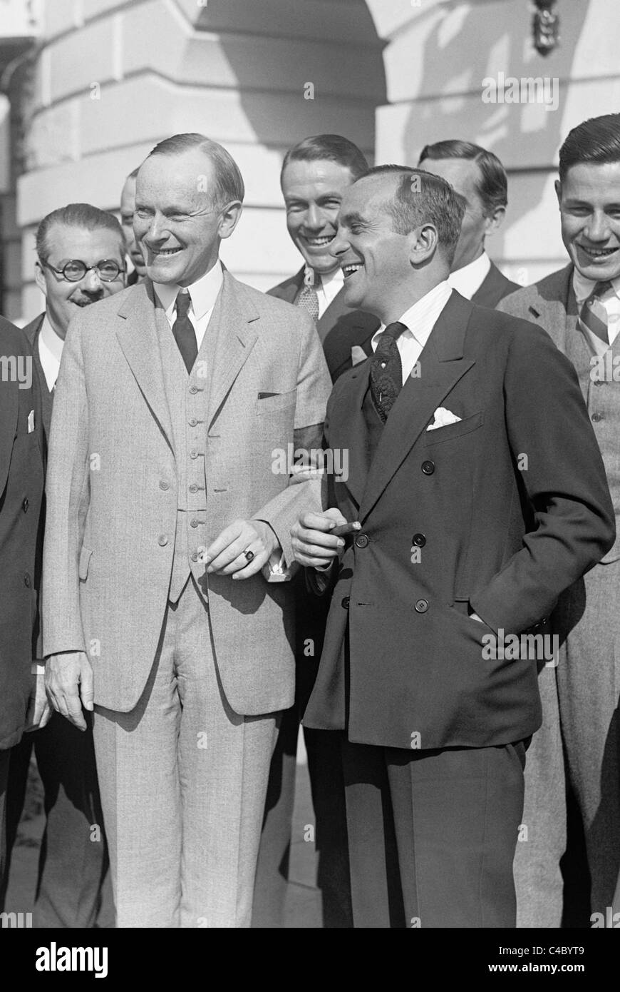 Vintage photo of US President Calvin Coolidge (left) and entertainer Al Jolson (right) outside the White House in - Stock Image