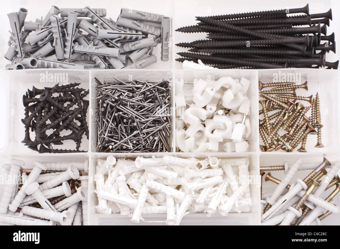 Screws, nails, dowels in the case - Stock Image