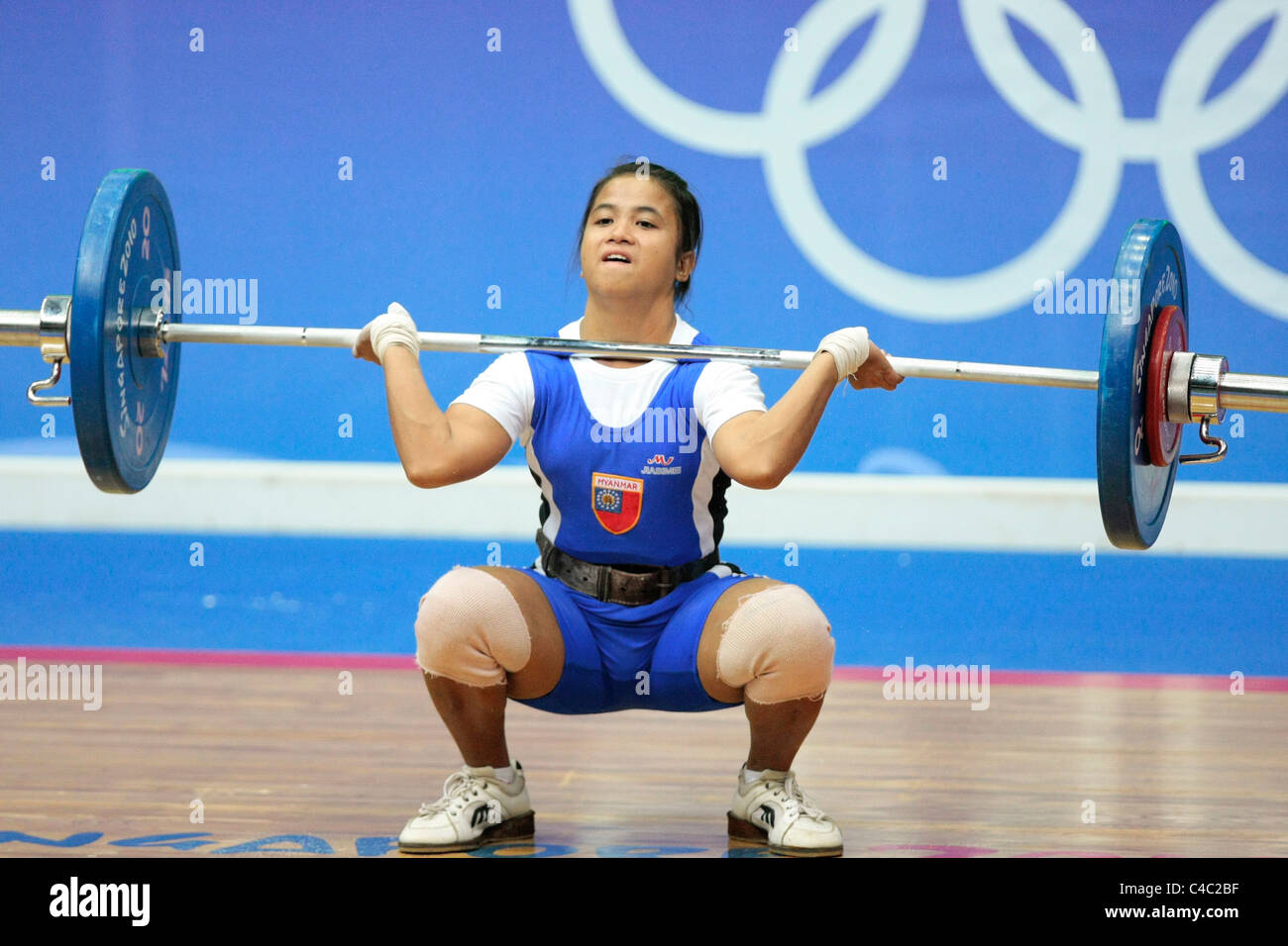 Myanmar's Kay Khine Khine in action during her clean and jerk routine. - Stock Image