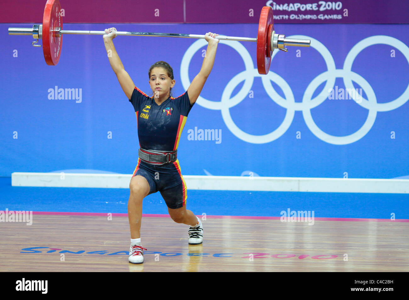 Spain's Atenery Hernandez in action during her clean and jerk routine. - Stock Image