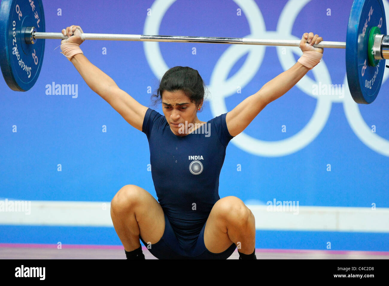 India's Santoshi Matsa in action during her snatch routine. - Stock Image