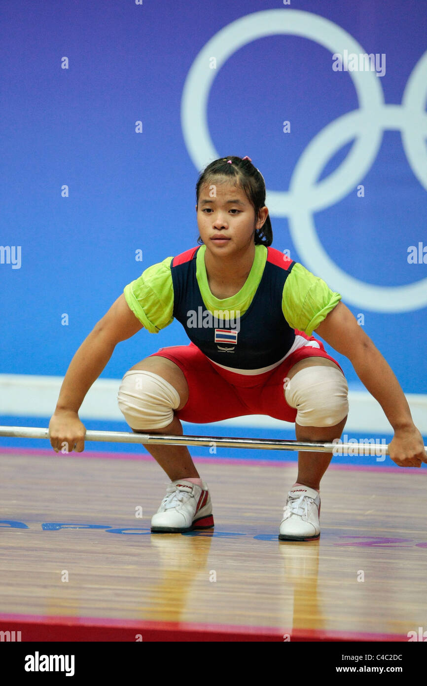hailand's Sirivimon Pramongkhol in action during her snatch routine. - Stock Image
