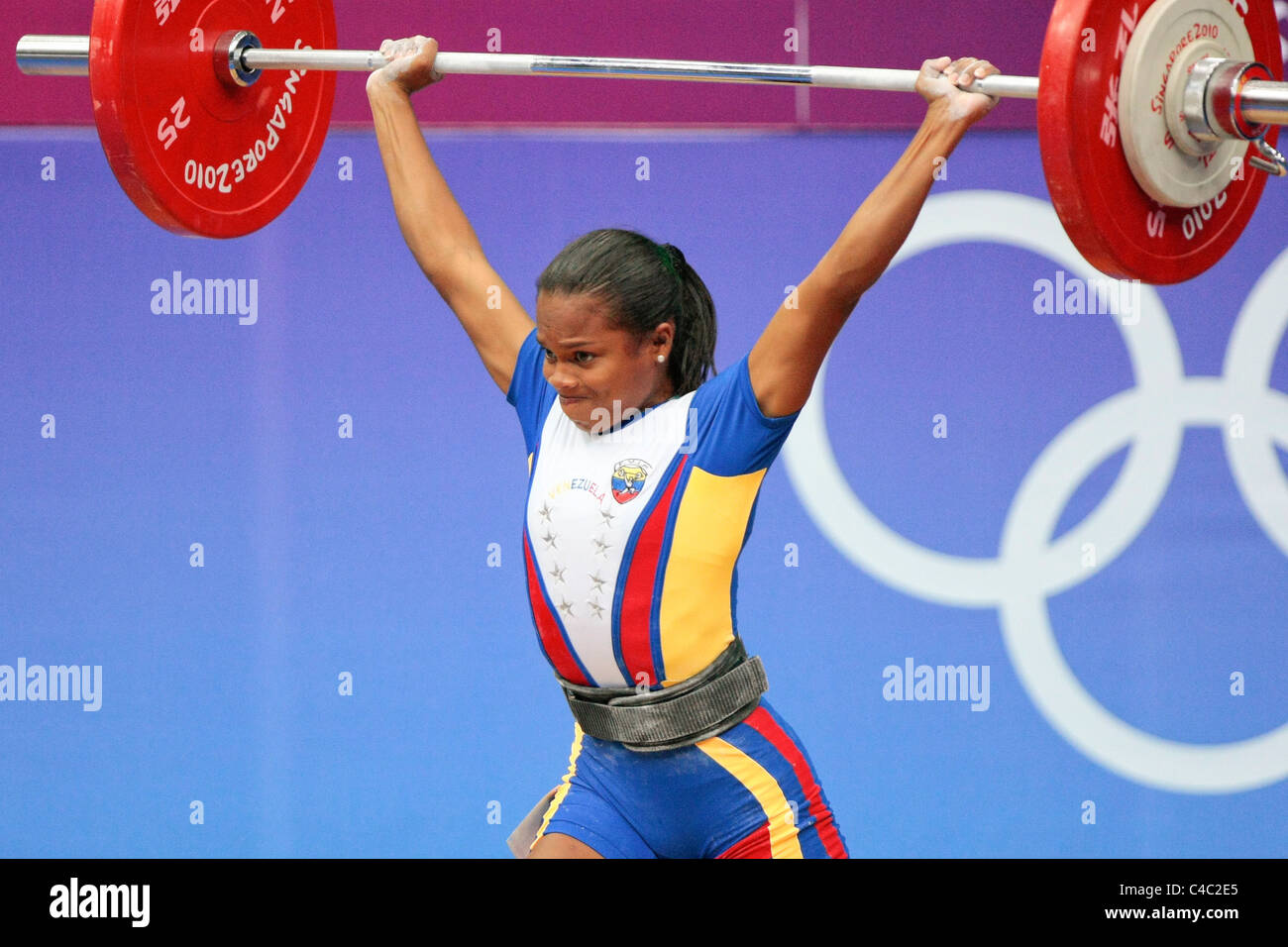 Venezuela's Genesis Rodriguez in action during her clean and jerk routine. - Stock Image