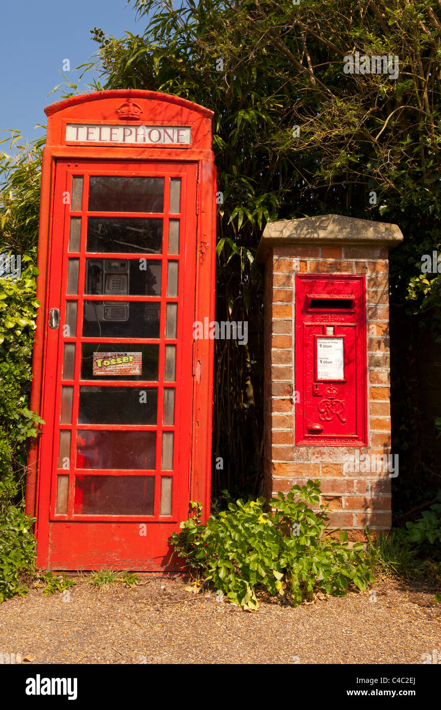 An old red telephone box and Royal Mail postbox at Dunwich , Suffolk , England , Britain , Uk - Stock Image