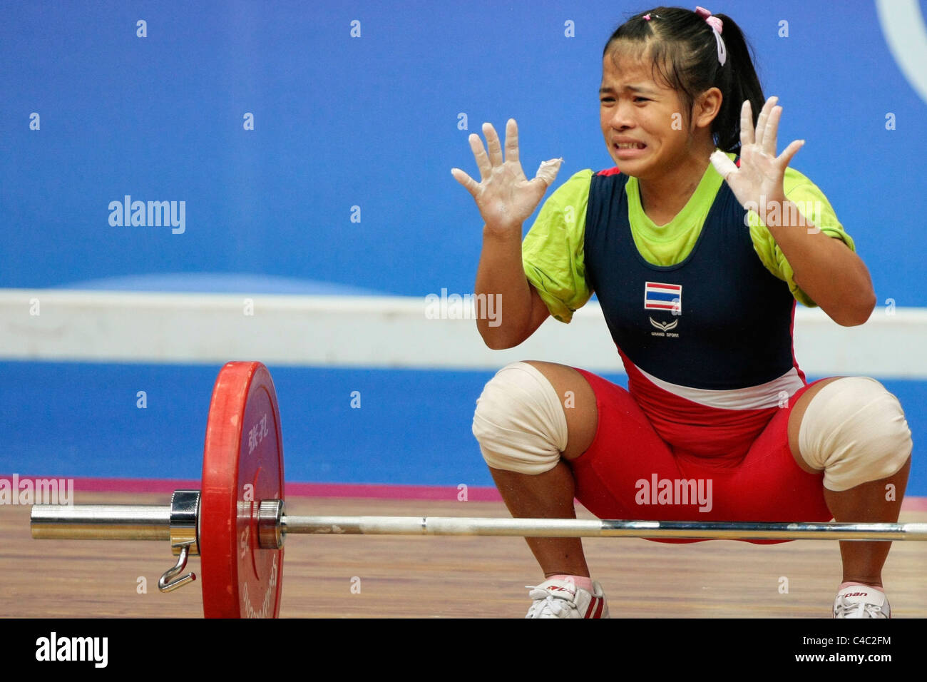 Thailand's Sirivimon Pramongkhol reacts after failing to lift during her snatch routine. - Stock Image