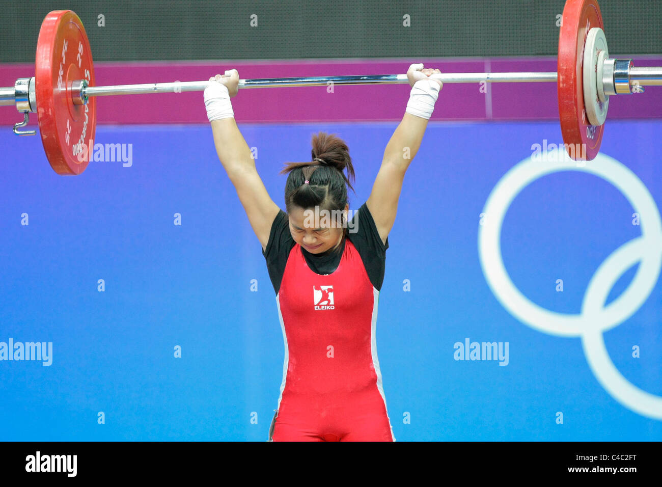 Vietnam's Nguyen Thi Hong in action during her clean and jerk routine. - Stock Image
