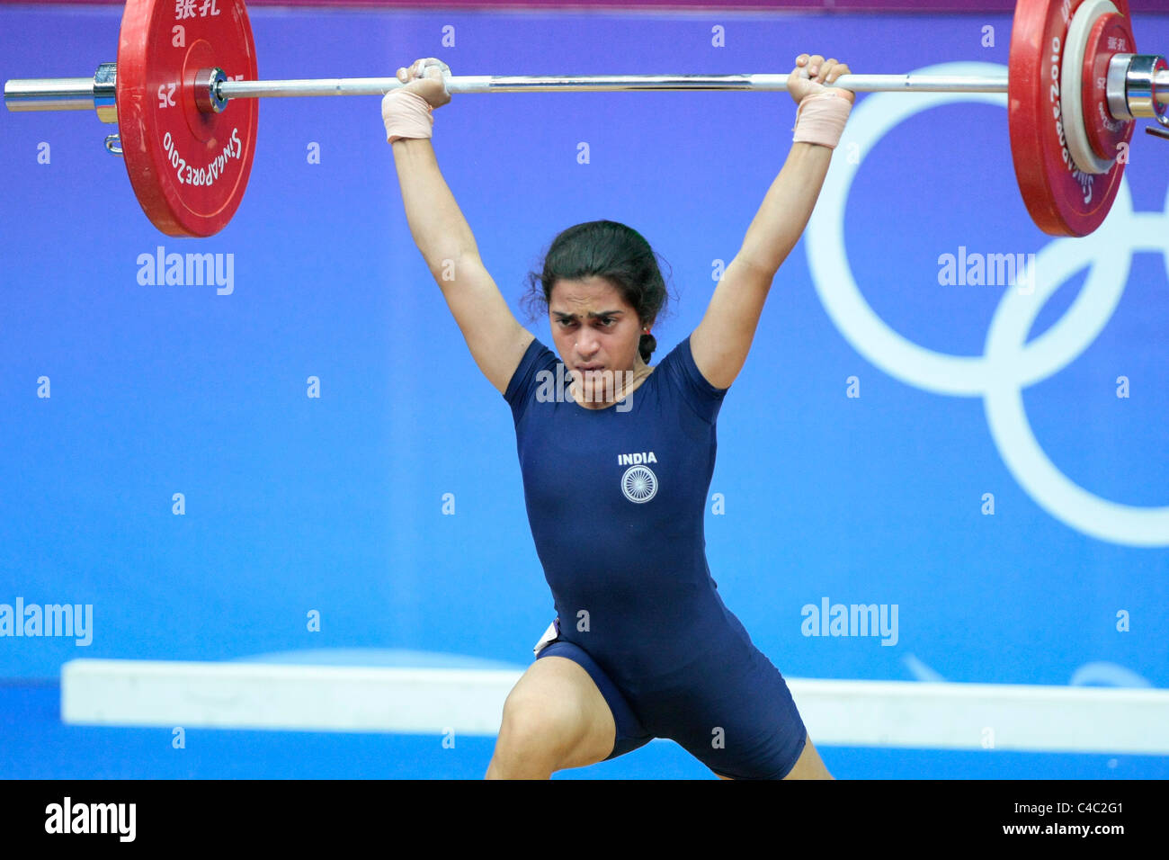 India's Santoshi Matsa in action during her clean and jerk routine. - Stock Image