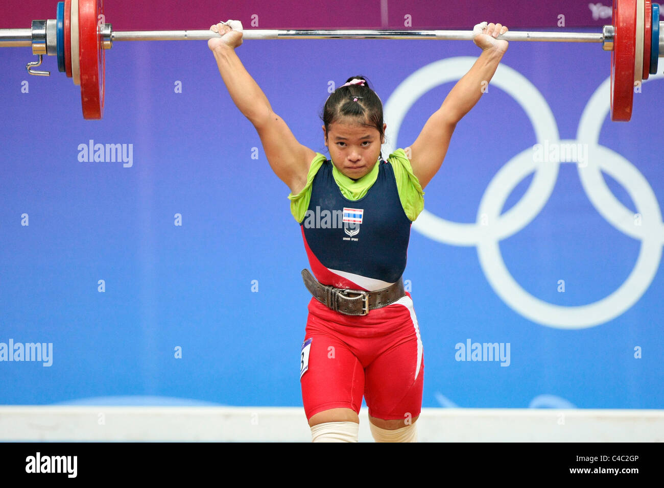Thailand's Sirivimon Pramongkhol in action during her clean and jerk routine. - Stock Image