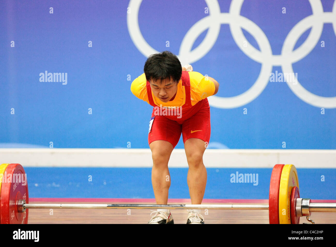 China's Tian Yuan taking a bow after her clean and jerk routine. - Stock Image