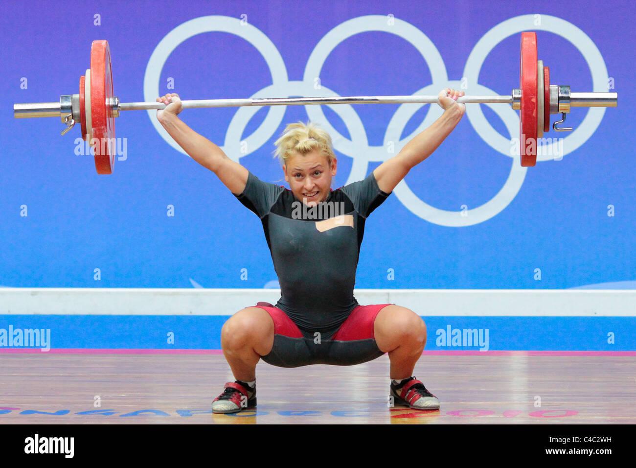 Boyanka Kostova of Bulgaria in action during her snatch routine. - Stock Image