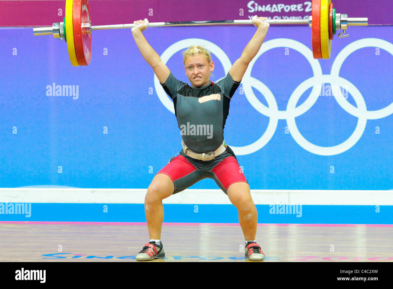 Boyanka Kostova of Bulgaria in action during her clean and jerk routine. - Stock Image