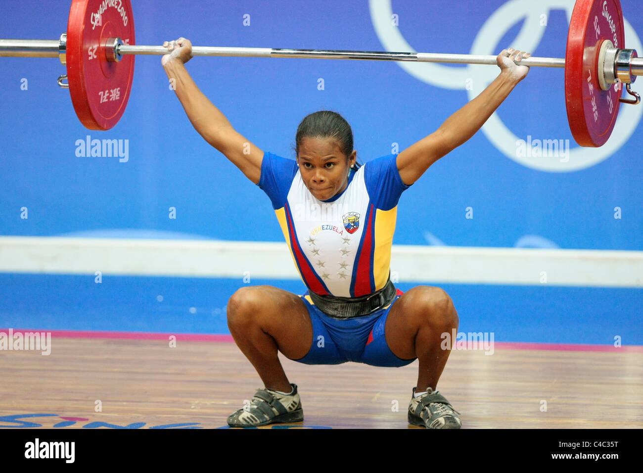 Venezuela's Genesis Rodriguez in action during her snatch routine. - Stock Image