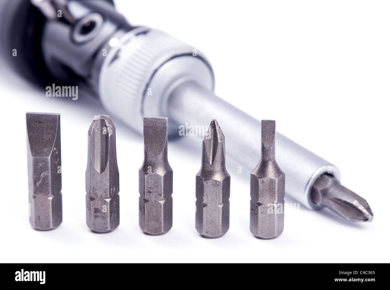 Screwdriver and removable bits isolated on white Stock Photo