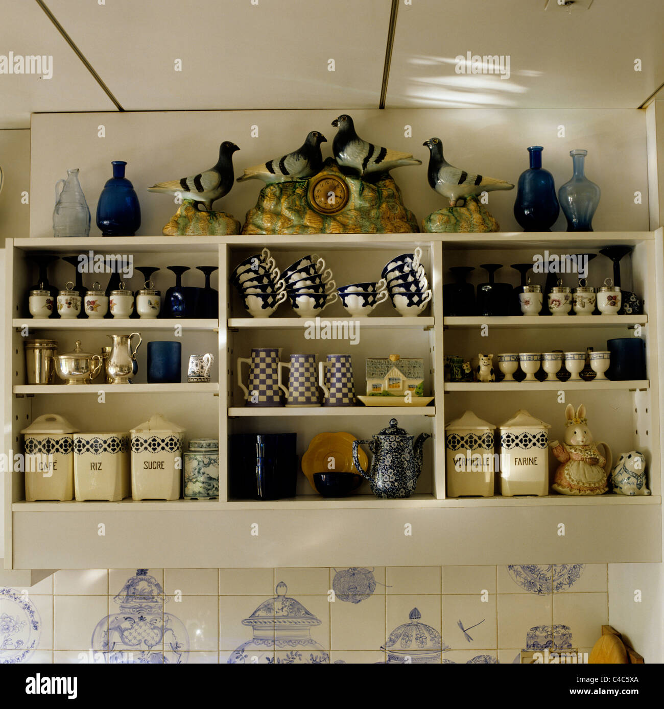 Assorted Country Style Crockery In Kitchen Shelving