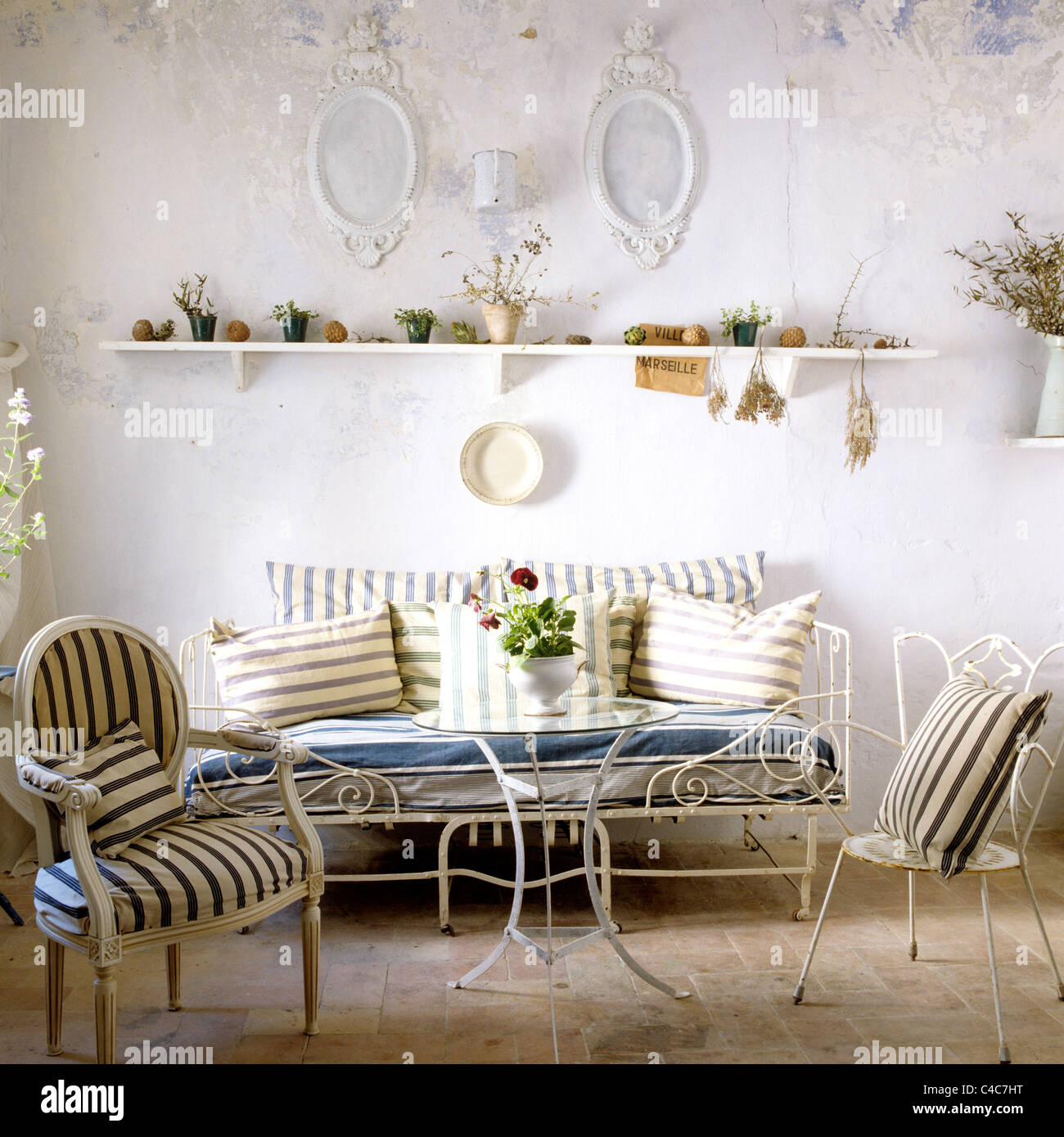 Living room with whitewashed walls, wrought iron furniture and Stock ...