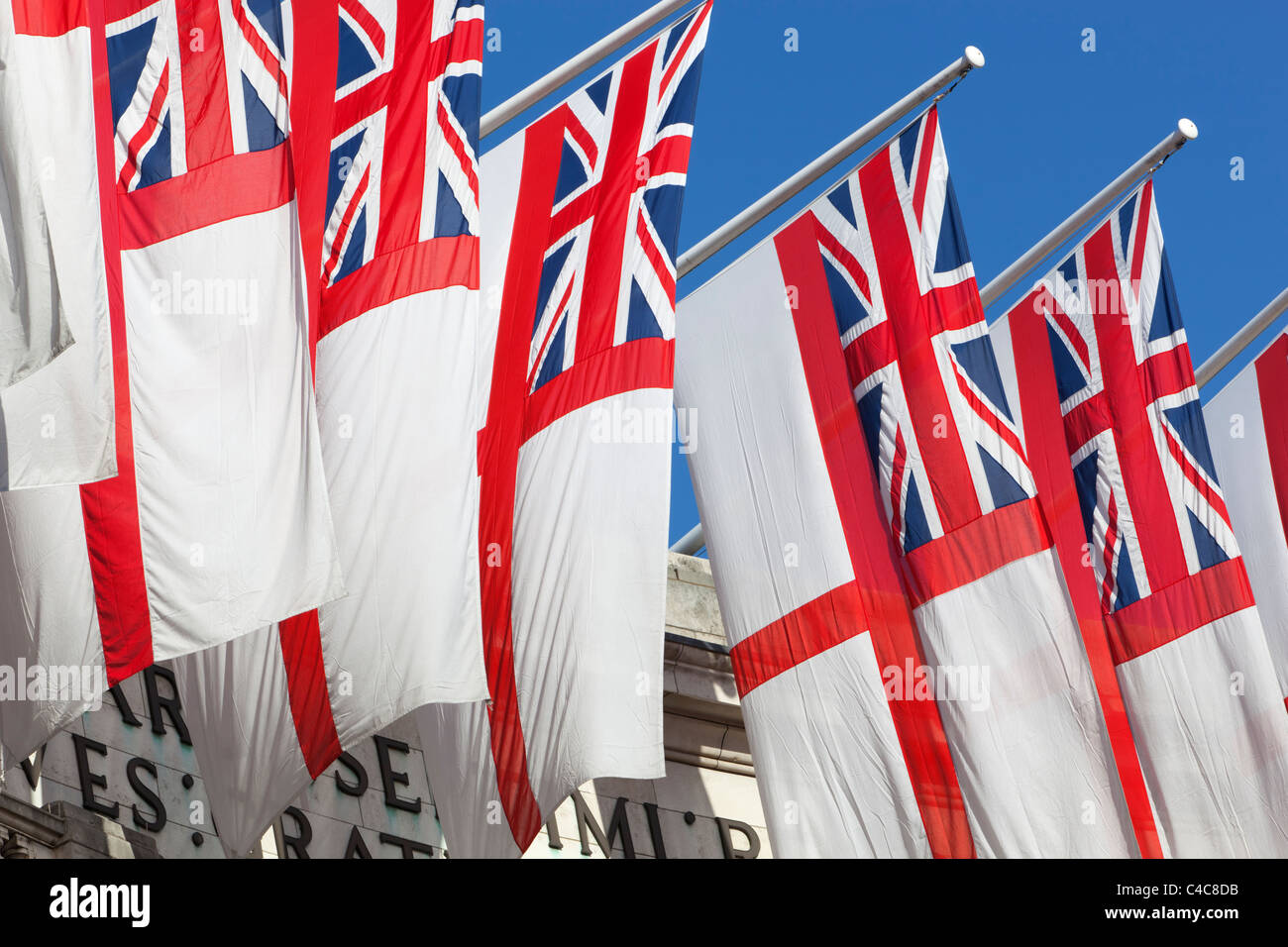Royal Navy White Ensigns flying above Admiralty Arch along The Mall in London - Stock Image