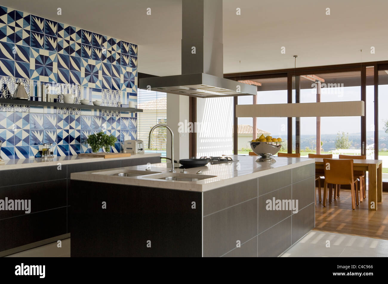 View across modern bulthaup kitchen with bihara stone worktop on to