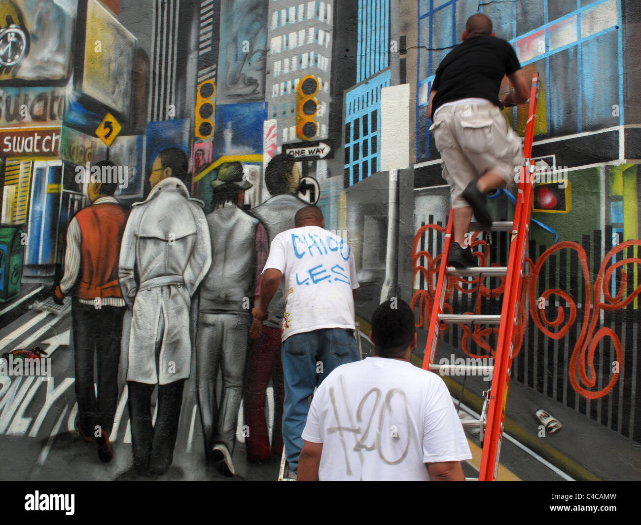 Graffiti artists at work on East Houston Street, New York - Stock Image