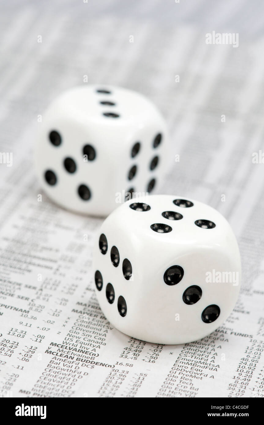 Dice on print out of market listings - Stock Image