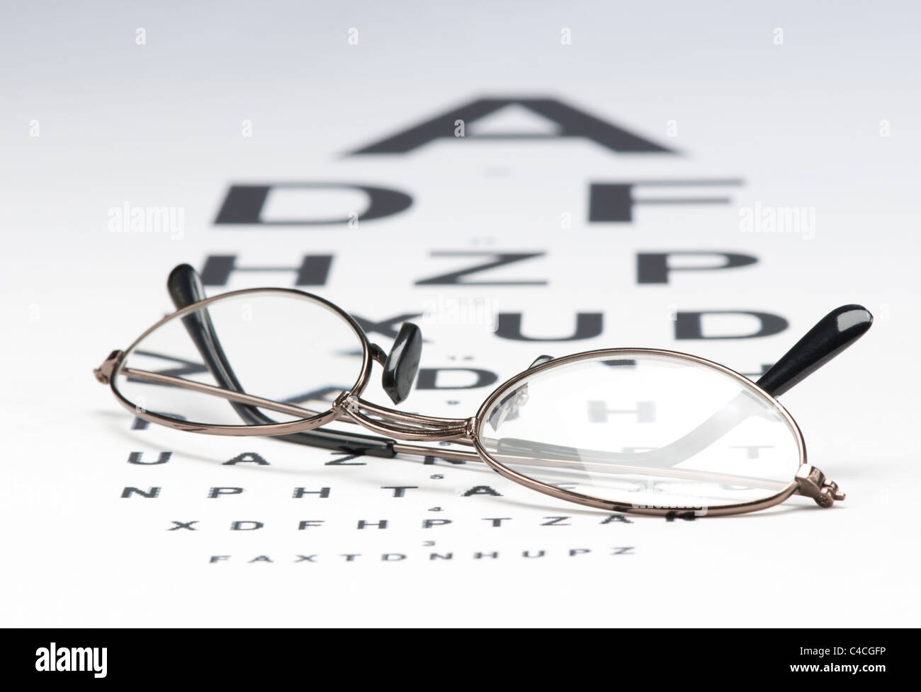 Eye glasses on Snellen chart - Stock Image