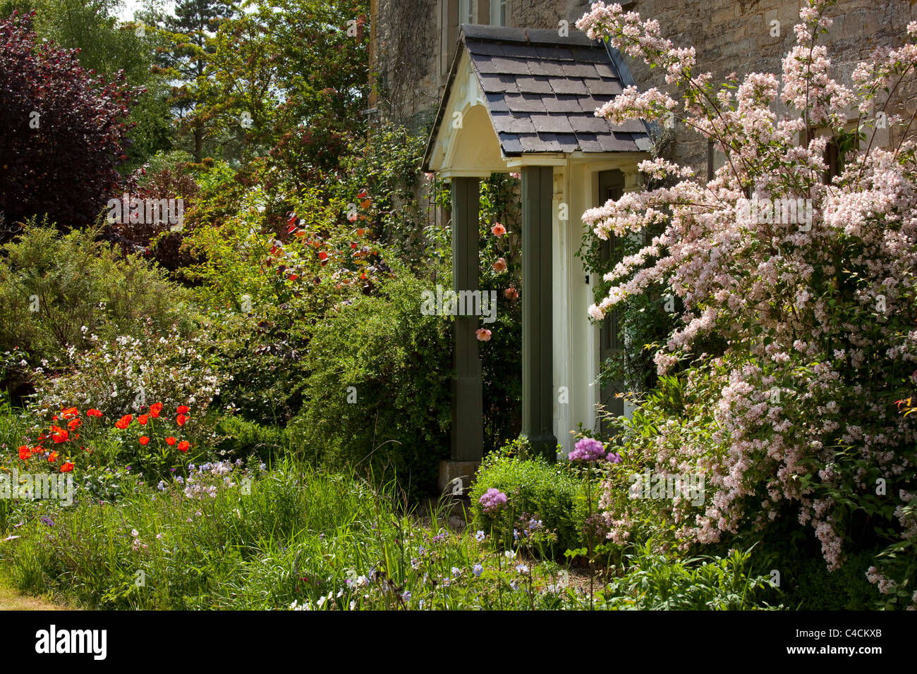 Porch and doorway of old english farmhouse,england - Stock Image
