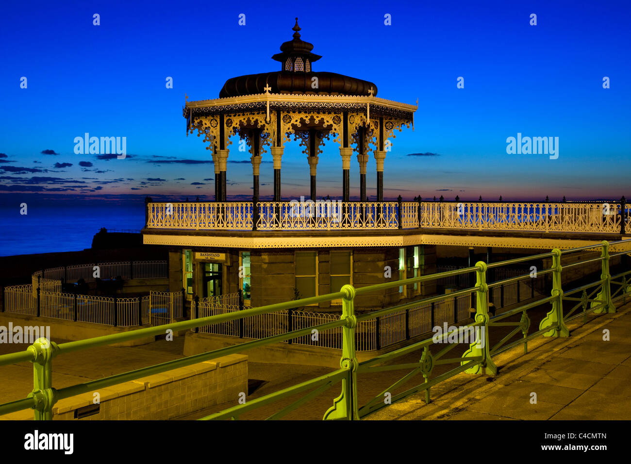 Victorian bandstand on seafront promenade at night , Brighton ,Sussex, England Stock Photo