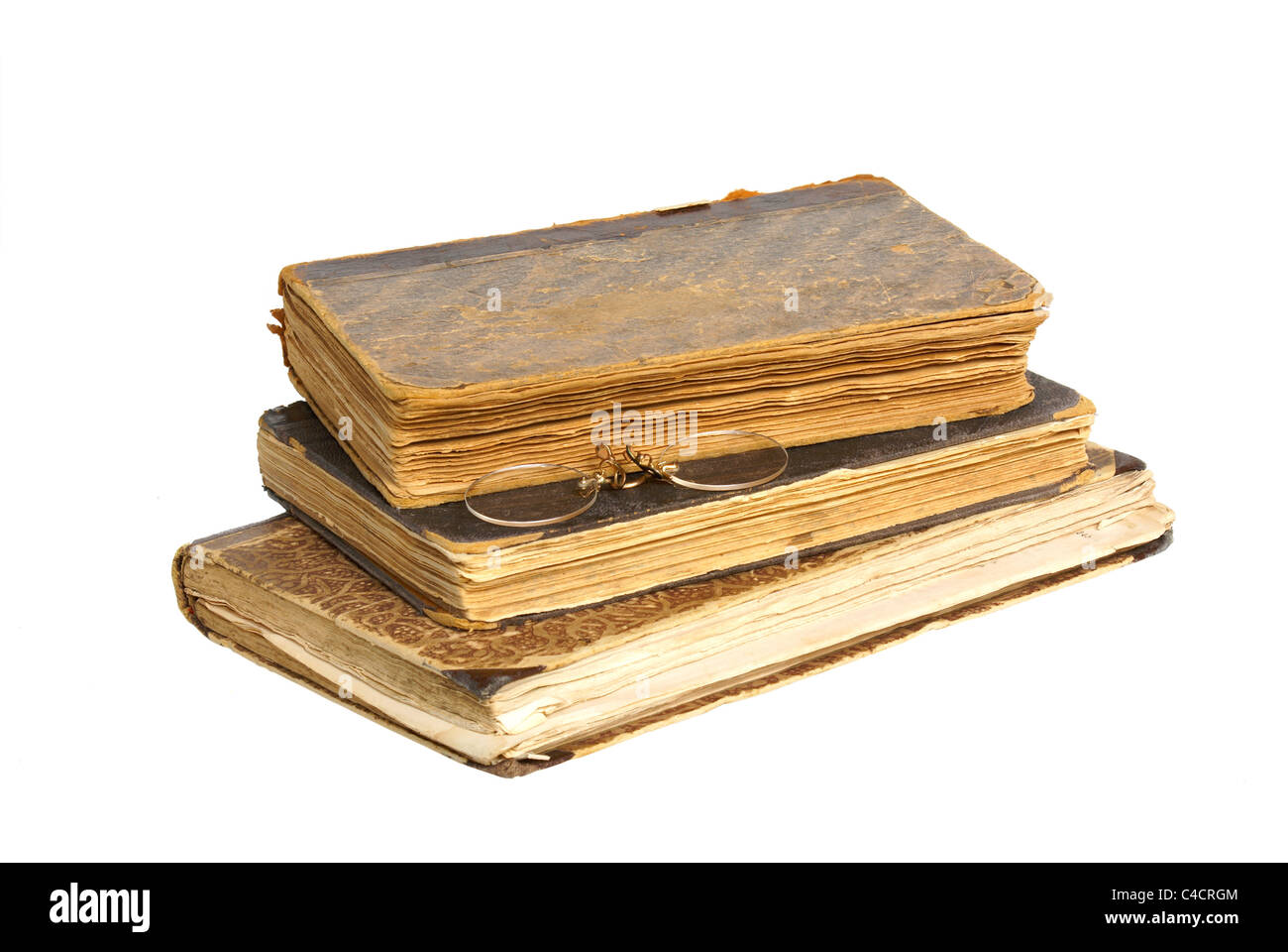 antique book with glasses isolated on white background - Stock Image