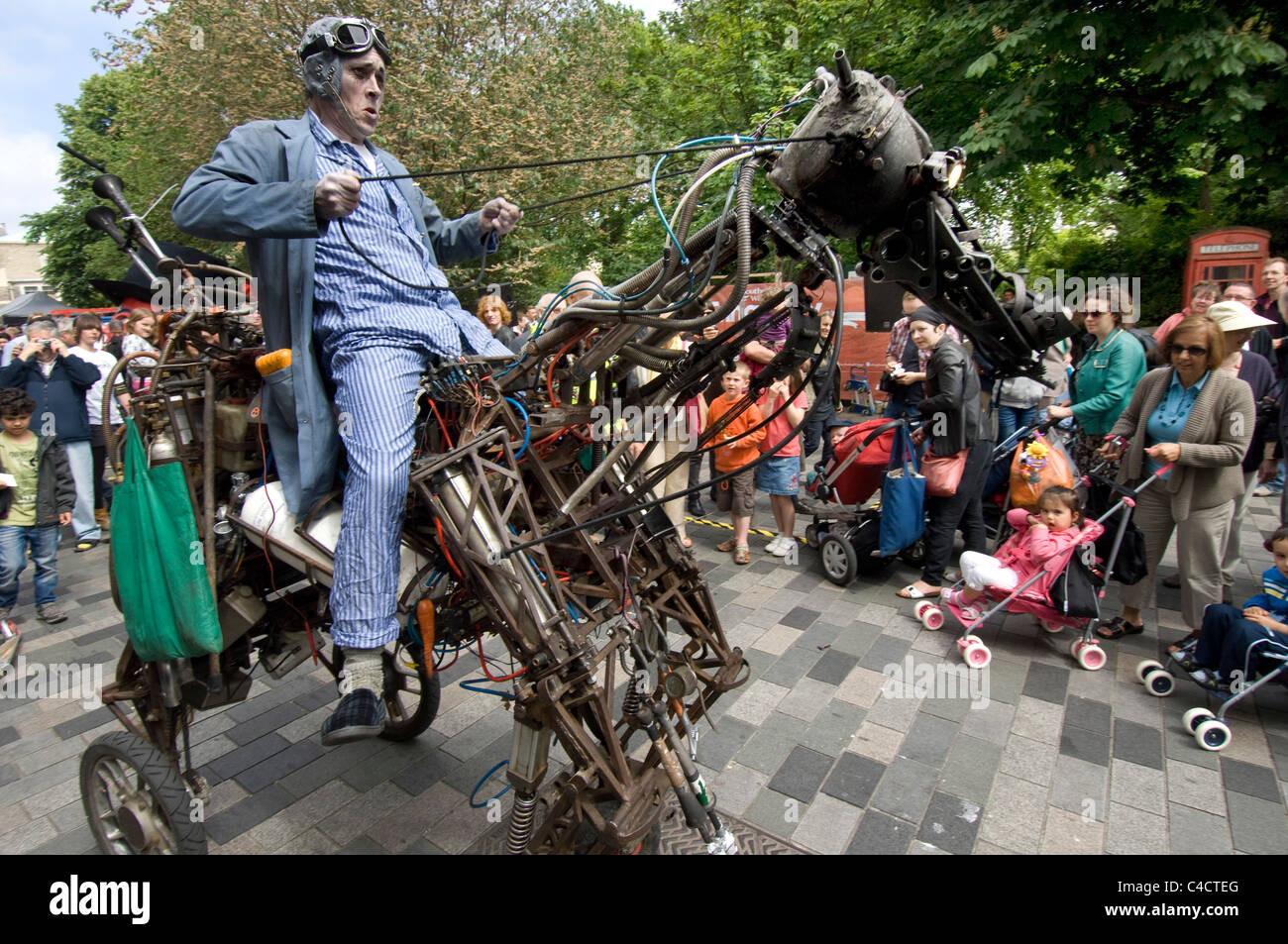 A street entertainer rides his iron horse during the 2011 Brighton Festival Fringe - Stock Image