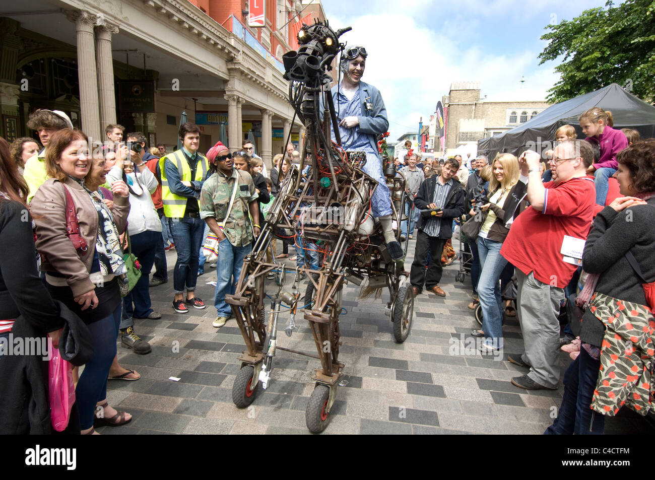 A street entertainer rides his recycled metal horse during the 2011 Brighton Festival Fringe - Stock Image