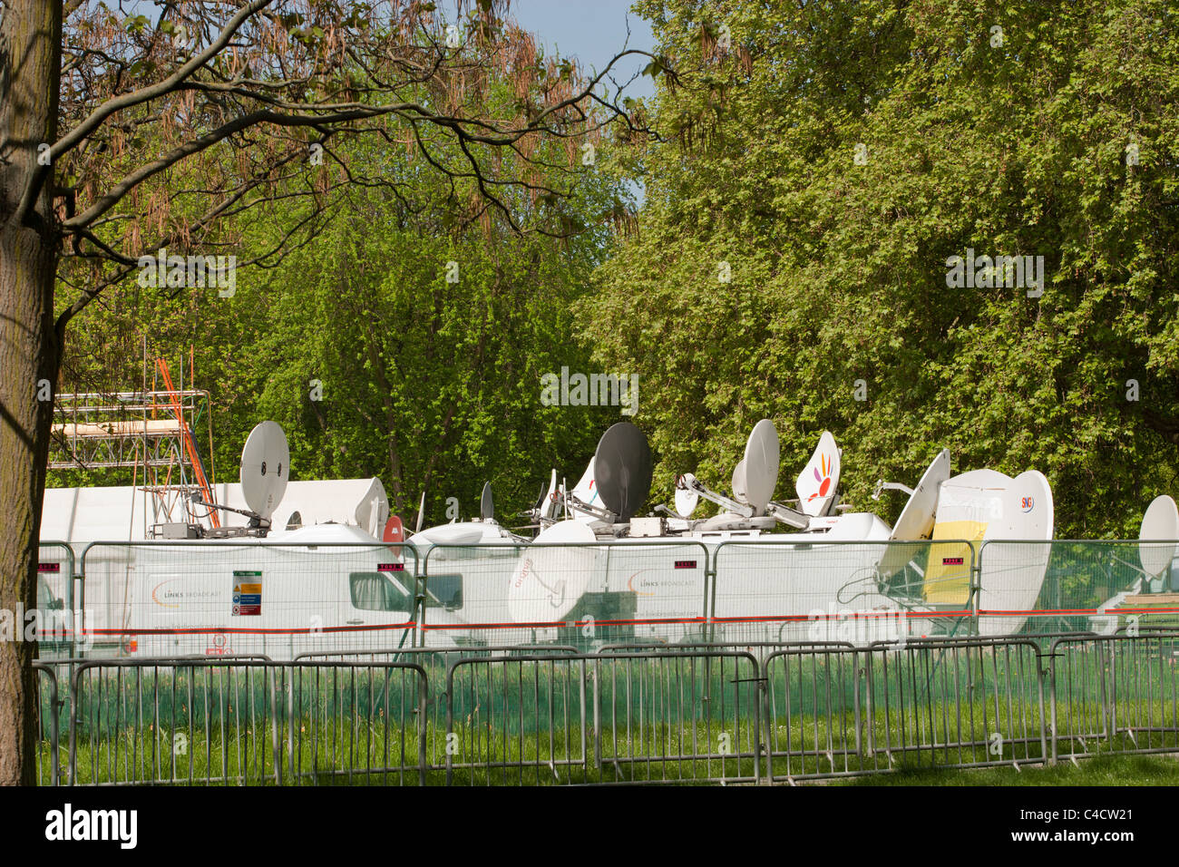 Television broadcasters vans and Satellites parked in green Park prior to the Royal Wedding April 2011 Stock Photo