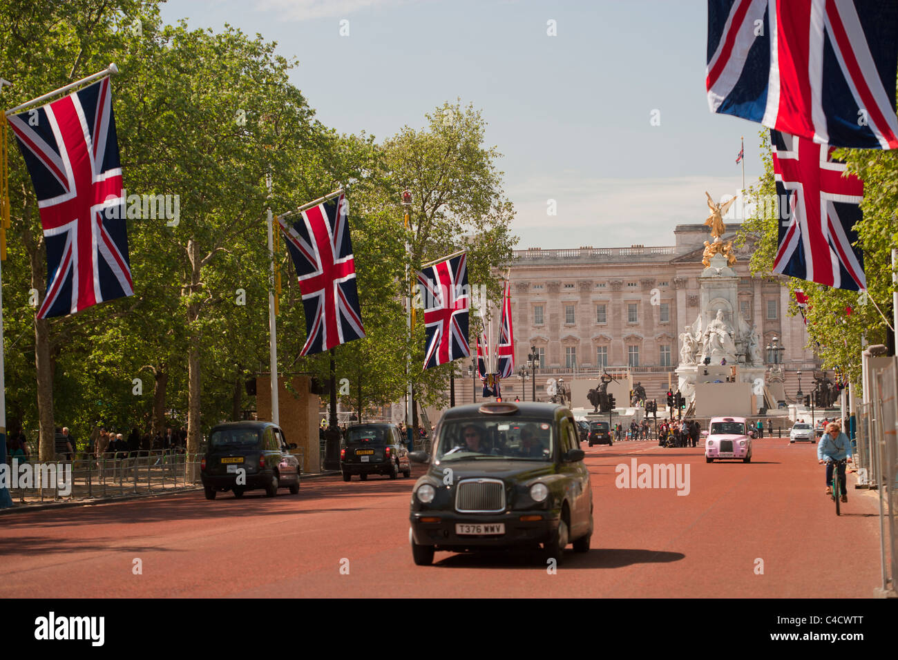 Union Flags flying down the Mall, London, UK at the time of the Royal wedding of Price William and Kate - Stock Image