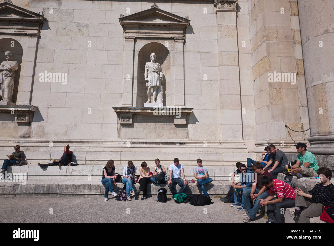 Detail of the side of the Glyptothek, a museum in Munich, Germany housing Greek and Roman sculpture with students Stock Photo