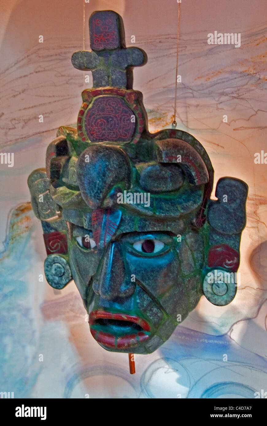 Replica of Mayan jade mask from Tikal tomb, found in 174 pieces, on display at La Casa del Jade (Jade Museum) in - Stock Image