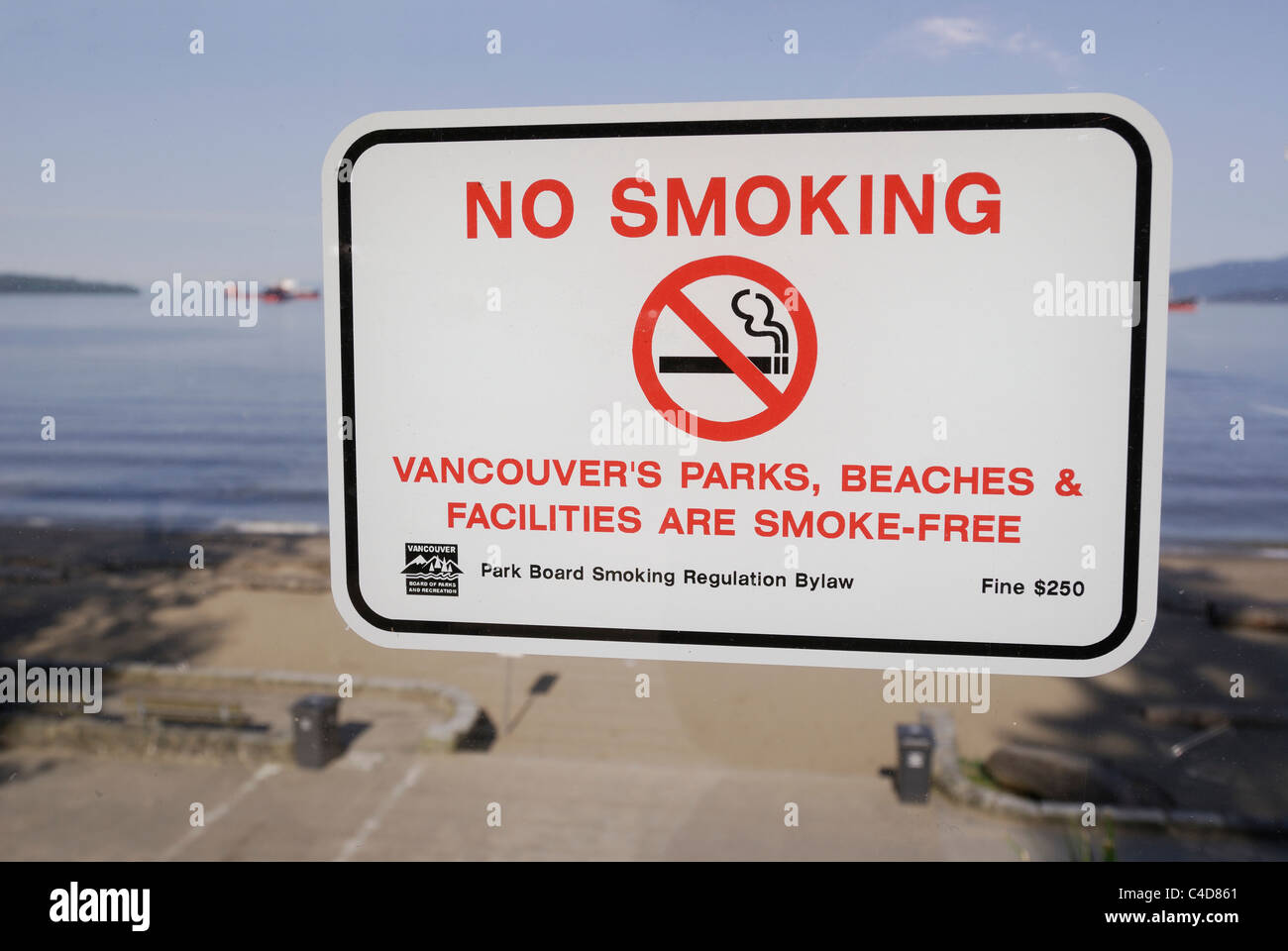 Vancouver park sign prohibiting smoking on all its beaches and parks. - Stock Image