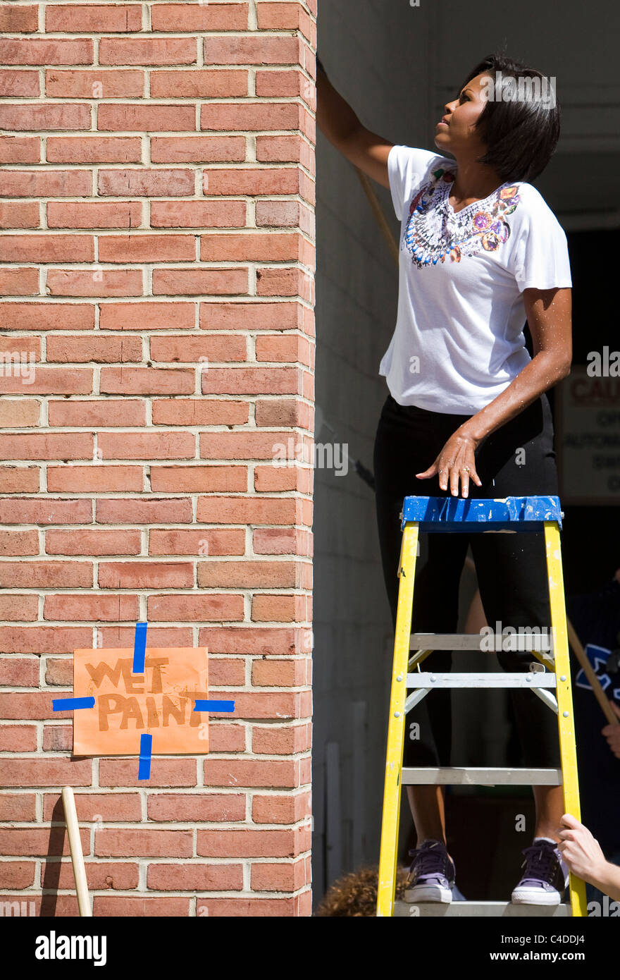 Michelle Obama helps to remodel a VA retirement home. - Stock Image
