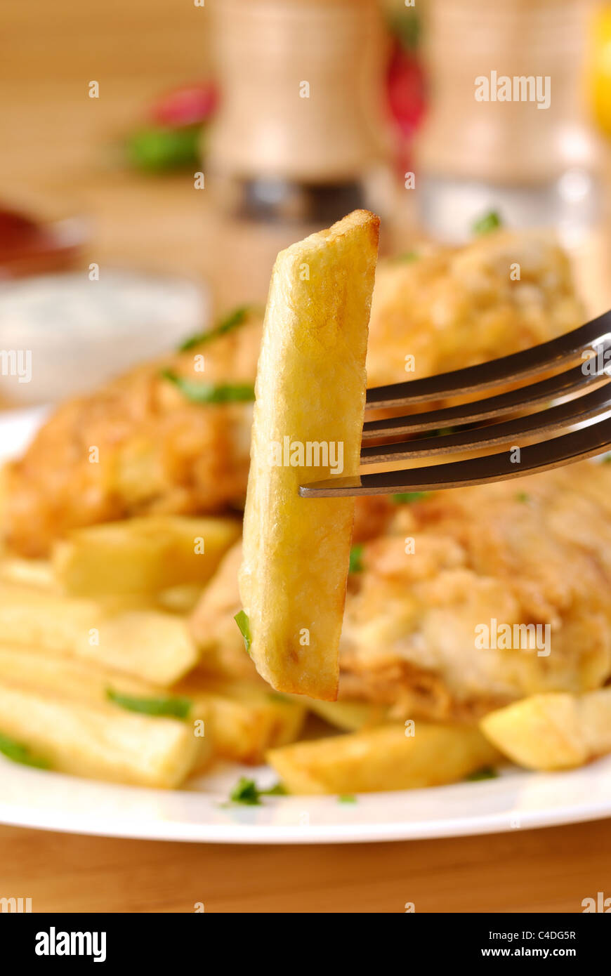 French fries, fish, mayo and spices - Stock Image