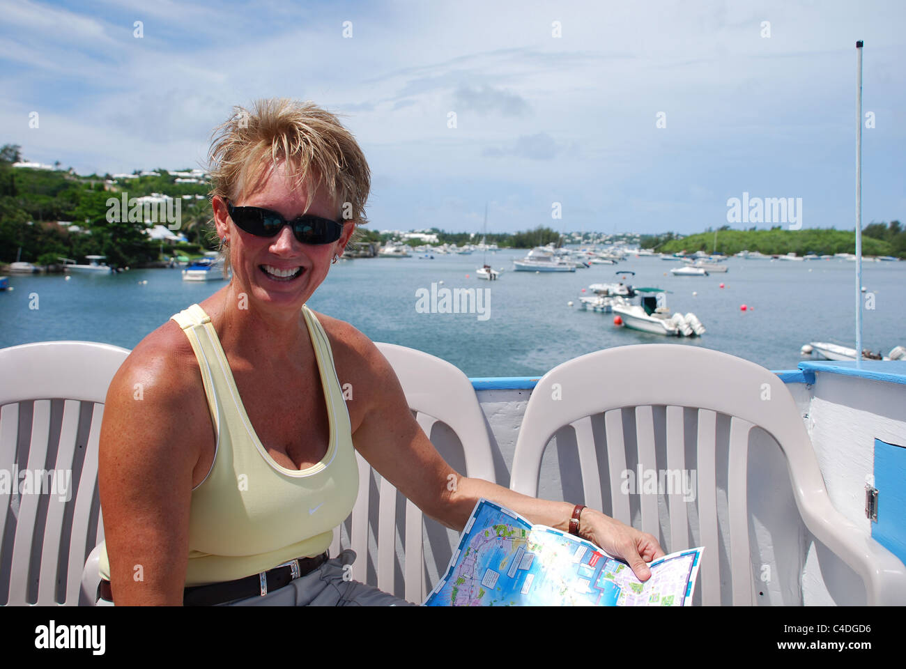Tourist on Rockaway Ferry in Bermuda with map; Southampton Parrish - Stock Image