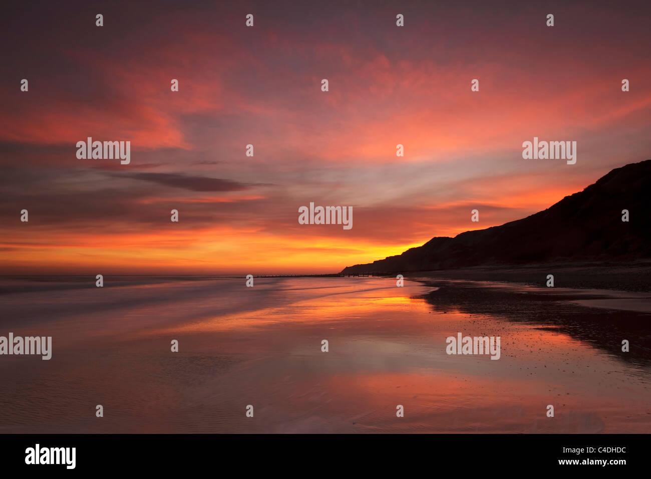 Early morning winter sunrise over cromer's east beach - North Norfolk Stock Photo