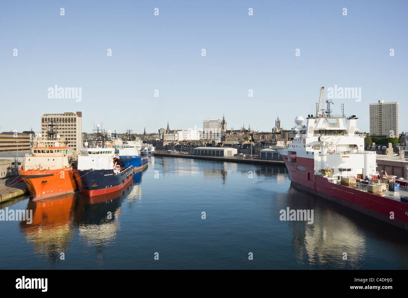 Ships docked in port supplying the rigs for the North Sea offshore oil industry. Aberdeen, Aberdeenshire, Scotland, - Stock Image
