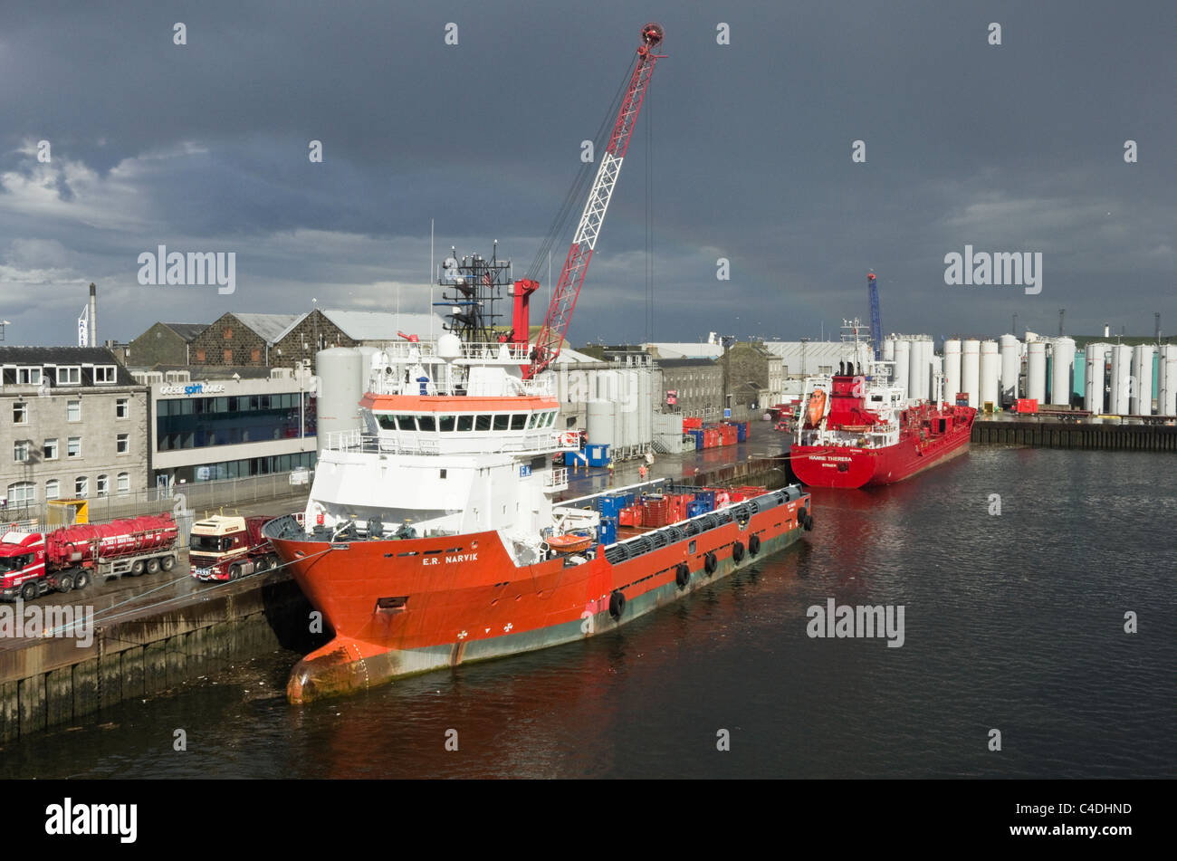 North sea offshore oil supply ships docked by the quay in the port of Aberdeen, Aberdeenshire, Scotland, UK, Britain. - Stock Image