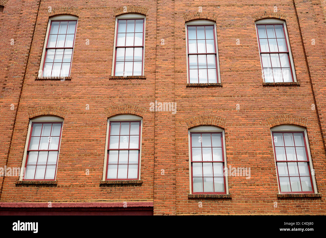 Windows on an exterior apartment buildng wall. - Stock Image