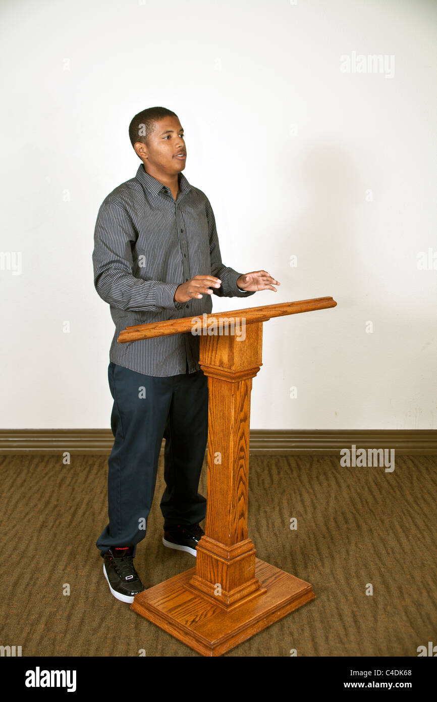 Ethnic minority African-American teenage boy speaking to audience. MR © Myrleen Pearson - Stock Image