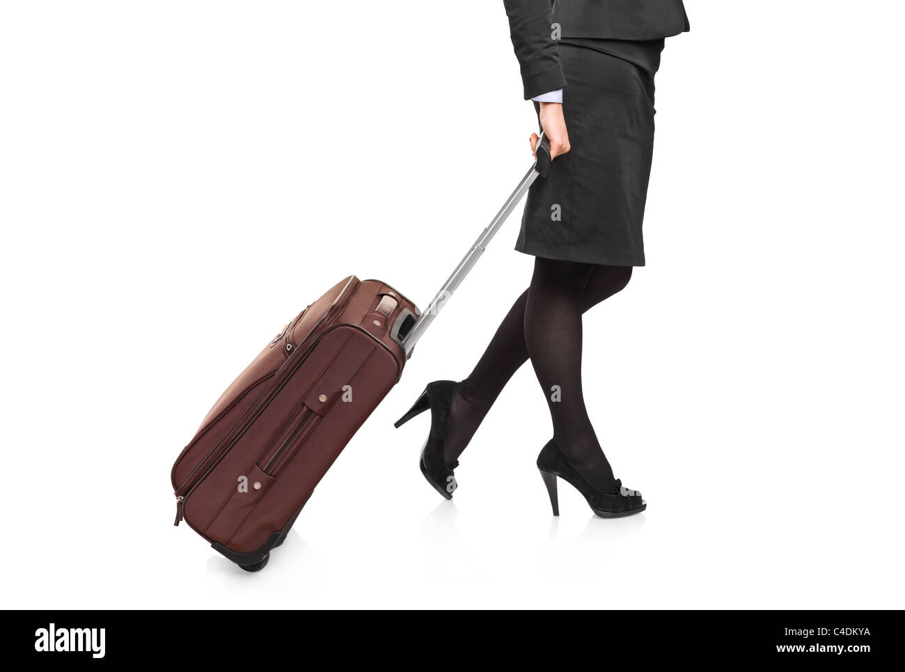 Businesswoman carrying a luggage - Stock Image