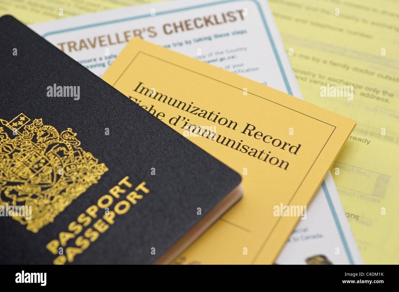 Passport, Immunization Record and Travel Checklist, Canadian - Stock Image
