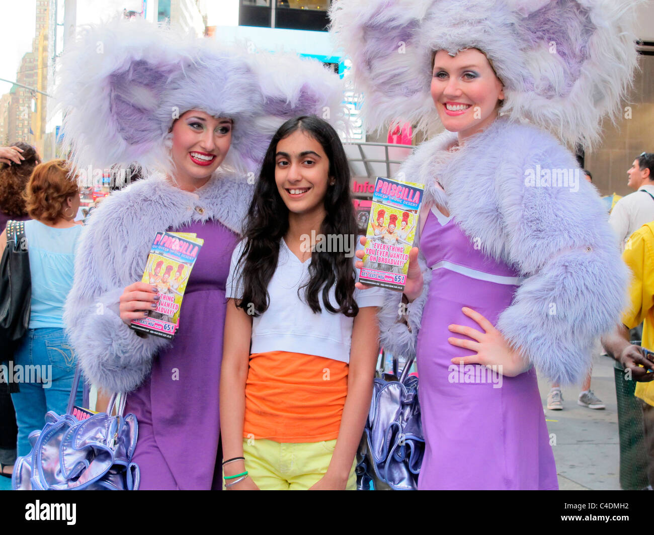 Young girl posing with Priscilla - Queen of the Desert promoters in Times Square New York City - Stock Image