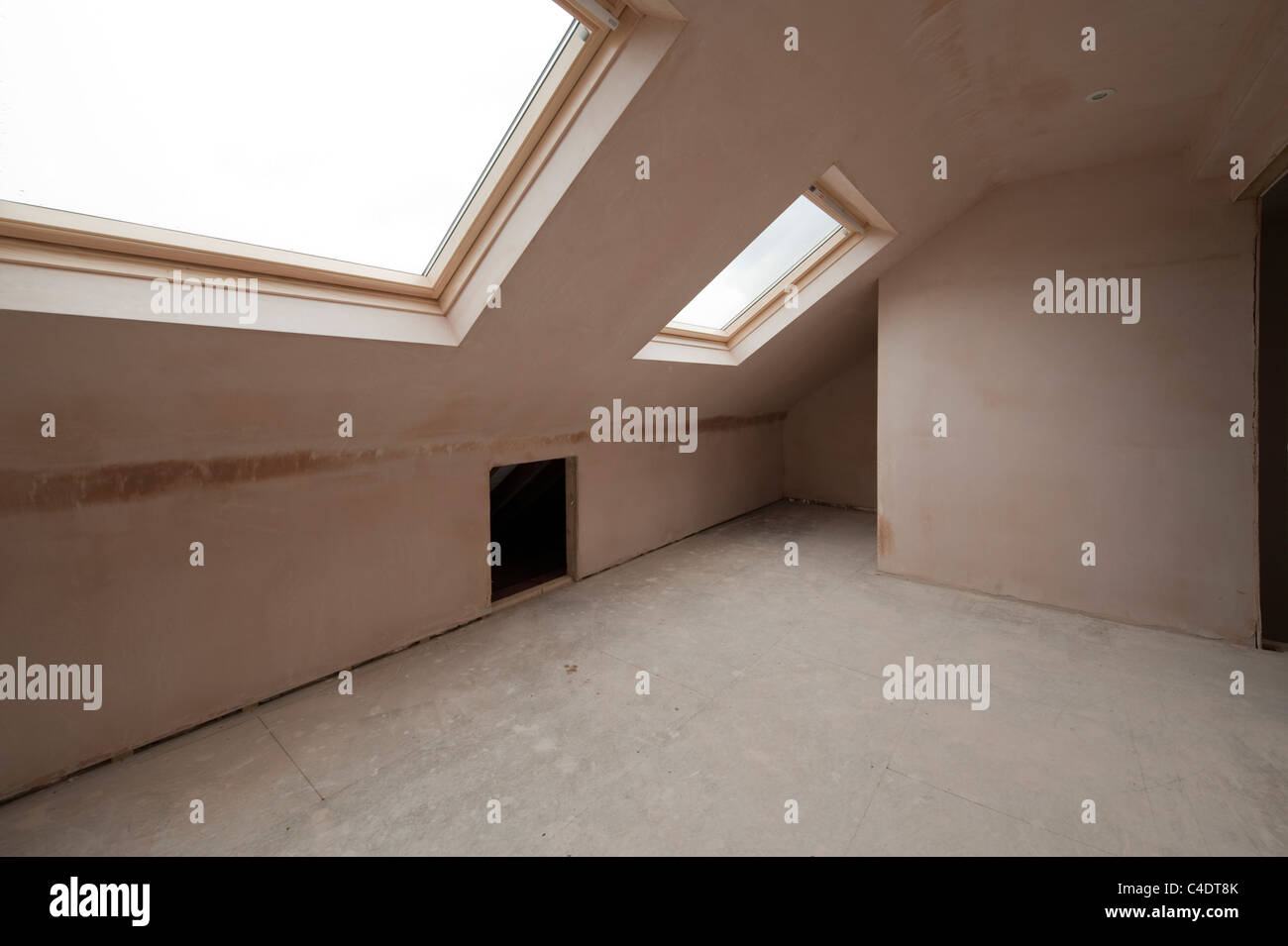 Newly built loft attic room in roof slope with Velux windows awaiting carpentry and decoration & Attic Room Storage Stock Photos \u0026 Attic Room Storage Stock Images ...